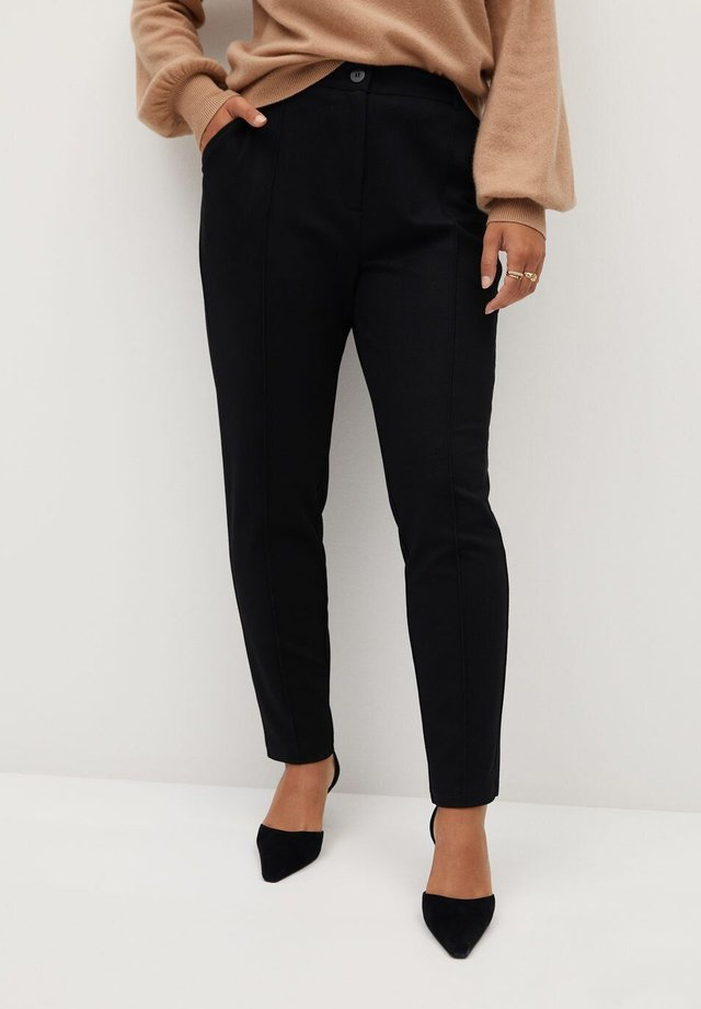 TRAVEL - Trousers - black
