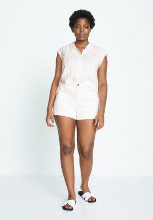 VICKY - Denim shorts - weiß