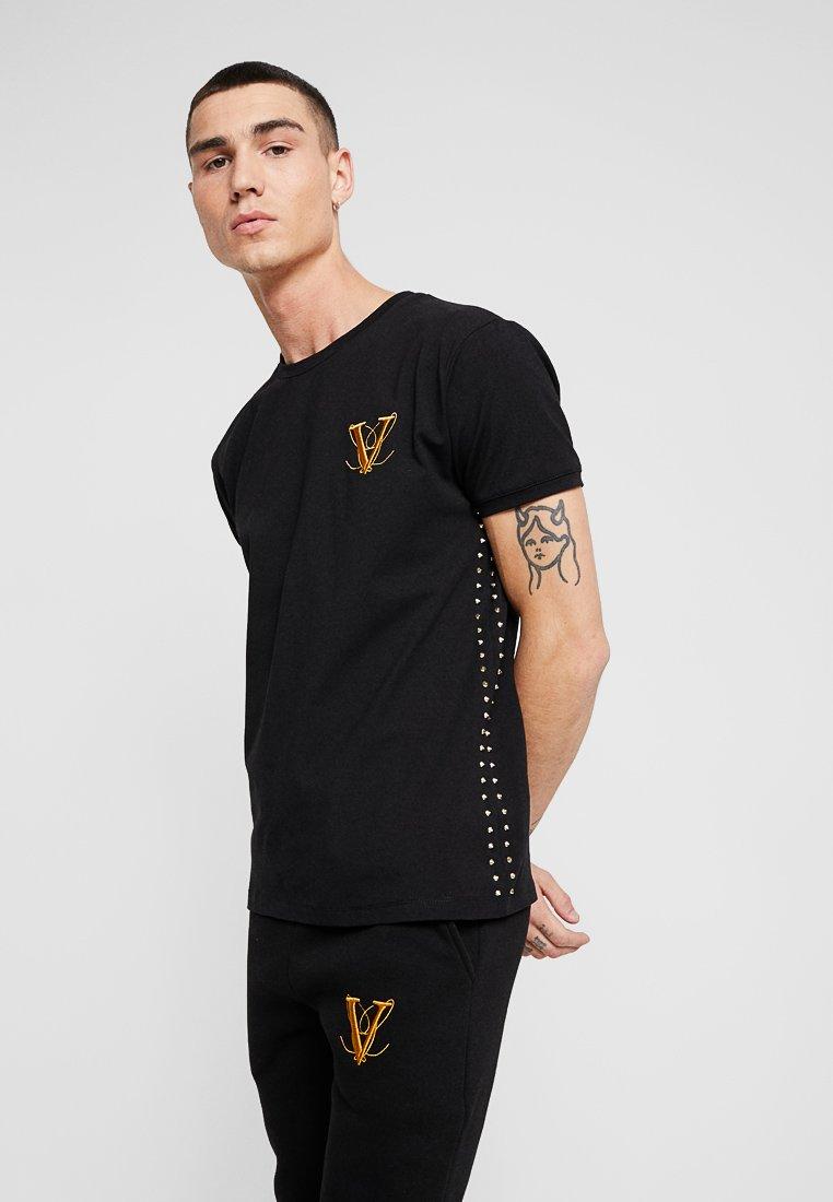 Volé la lumière  - GOLD SPIKE - Print T-shirt - black