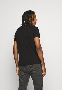 Volé la lumière - RHINESTONE KING SKULL - Print T-shirt - black - 2