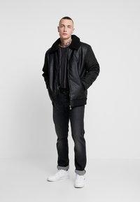 Volé la lumière - BORG COLLAR JACKET - Faux leather jacket - black - 1