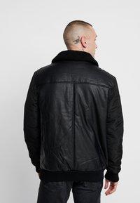 Volé la lumière - BORG COLLAR JACKET - Faux leather jacket - black - 2
