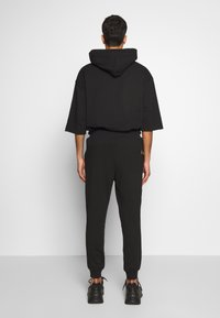 Vivienne Westwood Anglomania - CLASSIC TRACKSUIT BOTTOMS TIME TO ACT - Tracksuit bottoms - black - 2