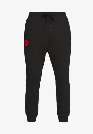 CLASSIC TRACKSUIT BOTTOMS TIME TO ACT - Tracksuit bottoms - black