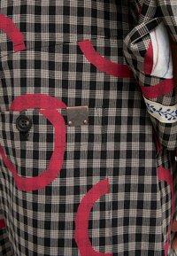 Vivienne Westwood - Pantalon de costume - pinocchio - 7