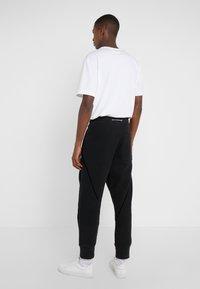 Vivienne Westwood - TRACKSUIT PANTS - Tracksuit bottoms - black - 2