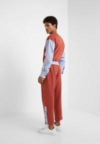 Vivienne Westwood - TRACKSUIT PANT - Tracksuit bottoms - brick - 2