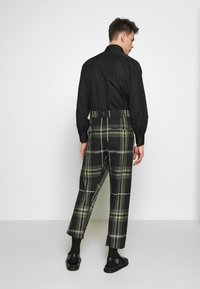 Vivienne Westwood Anglomania - ALCOHOLIC TROUSERS - Tygbyxor - black - 2