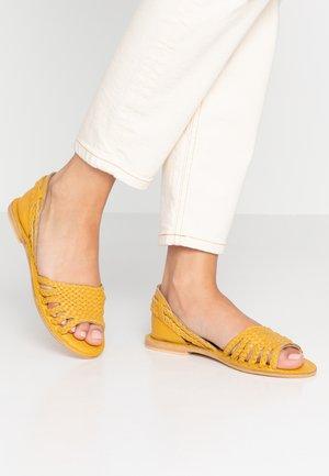 PLAITED HURRACHE - Sandals - mustard