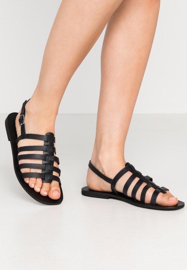 GLADIATOR  - Sandaalit nilkkaremmillä - black