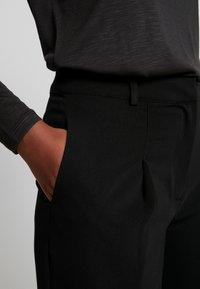 Warehouse - WIDE LEG TROUSERS - Trousers - black - 4