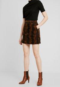 Warehouse - SNAKE PELMET SKIRT - A-line skirt - snake - 0
