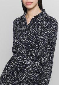 Warehouse - KIKA MOVEMENT MINI DRESS - Shirt dress - black - 5