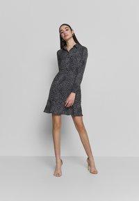Warehouse - KIKA MOVEMENT MINI DRESS - Shirt dress - black - 1