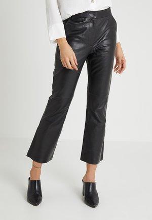 CROP KICK FLARE - Pantalones - black