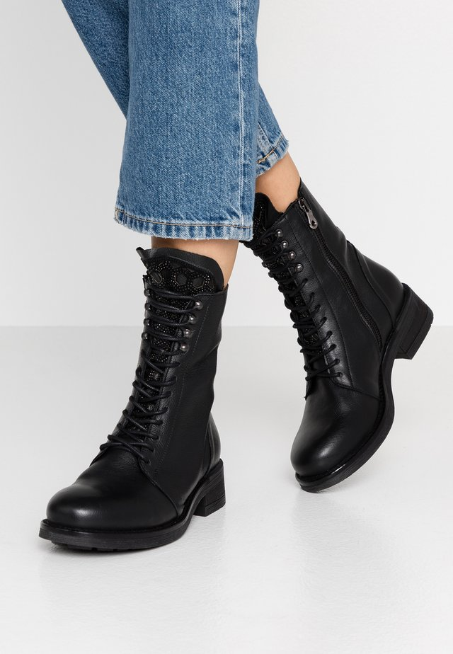 Lace-up ankle boots - rock nero