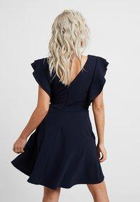 WAL G PETITE - EXCLUSIVE V NECK FRILL SLEEVE MINI DRESS - Jersey dress - navy - 3