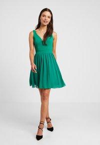 WAL G PETITE - V NECK BOTTOM MINI DRESS - Day dress - bright green - 1