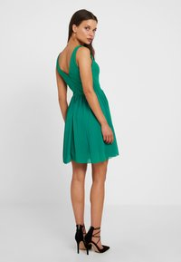WAL G PETITE - V NECK BOTTOM MINI DRESS - Day dress - bright green - 2