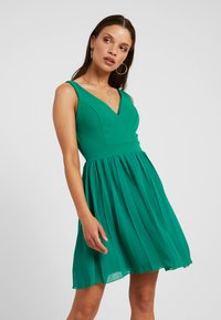 WAL G PETITE - V NECK BOTTOM MINI DRESS - Day dress - bright green - 0