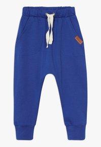 Walkiddy - LITTLE WHALE BAGGY 2 PACK - Trousers - orange/dark blue - 2
