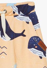 Walkiddy - LITTLE WHALE BAGGY 2 PACK - Trousers - orange/dark blue - 4