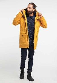 Schmuddelwedda - Winter coat - mustard - 1