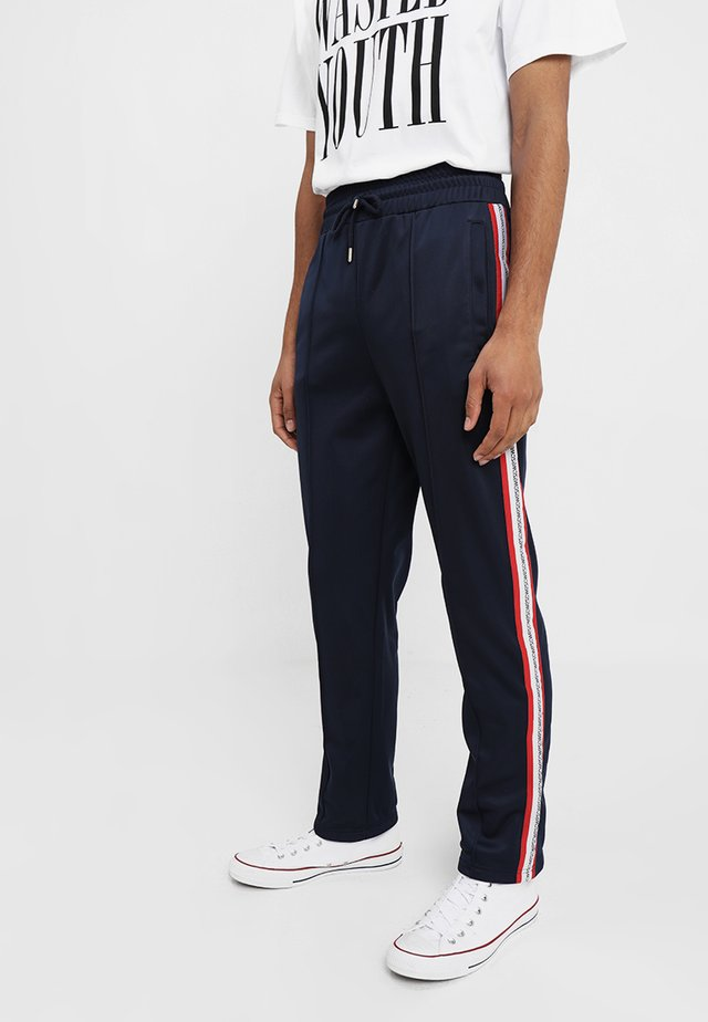 MARCEL - Tracksuit bottoms - navy