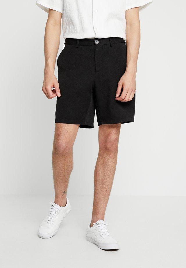 JANZIK  - Shorts - black