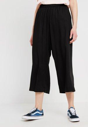 CELISE TROUSERS - Trousers - black