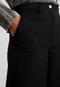 Weekday - KIM TROUSERS - Trousers - black - 6