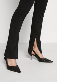 Weekday - ALECIA TROUSER - Trousers - black - 3