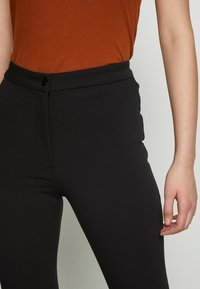 Weekday - ALECIA TROUSER - Trousers - black - 5
