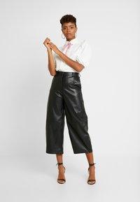 Weekday - REGINA TROUSER - Trousers - black - 1