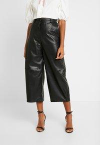 Weekday - REGINA TROUSER - Trousers - black - 0