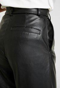 Weekday - REGINA TROUSER - Trousers - black - 5