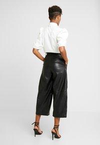 Weekday - REGINA TROUSER - Trousers - black - 2
