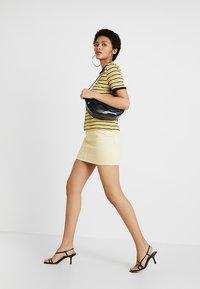 Weekday - WEND SKIRT - Jupe en jean - pale yellow - 1