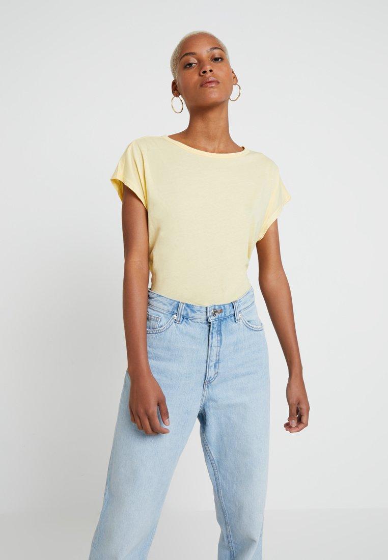 Weekday - CUBA - T-Shirt basic - light yellow