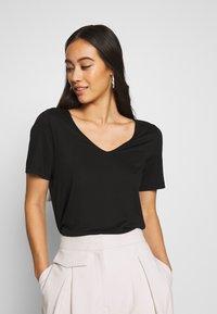 Weekday - ABBY - T-shirts - black - 0