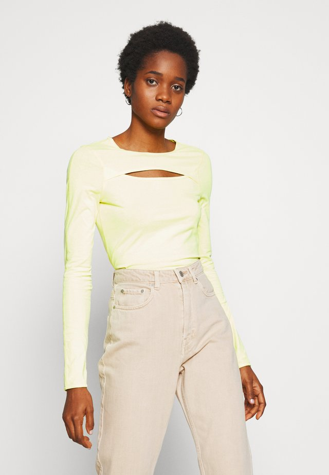 CARLA CUT OUT LONG SLEEVE - Long sleeved top - acid yellow