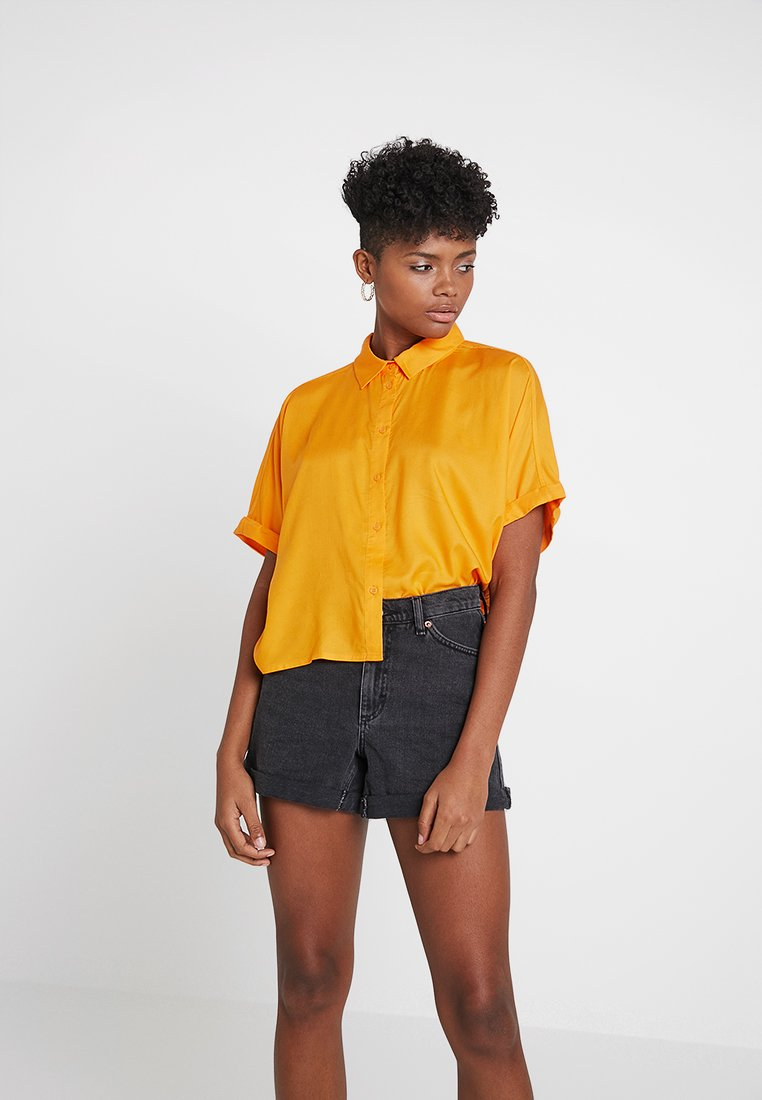 Weekday - GROOVE BLOUSE - Button-down blouse - orange
