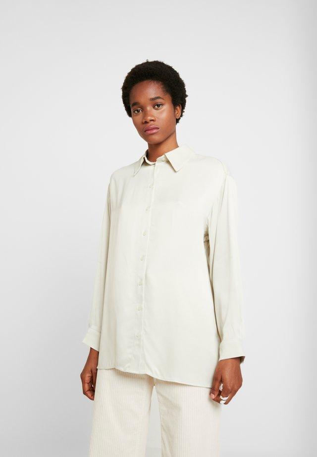 CAROL - Button-down blouse - beige