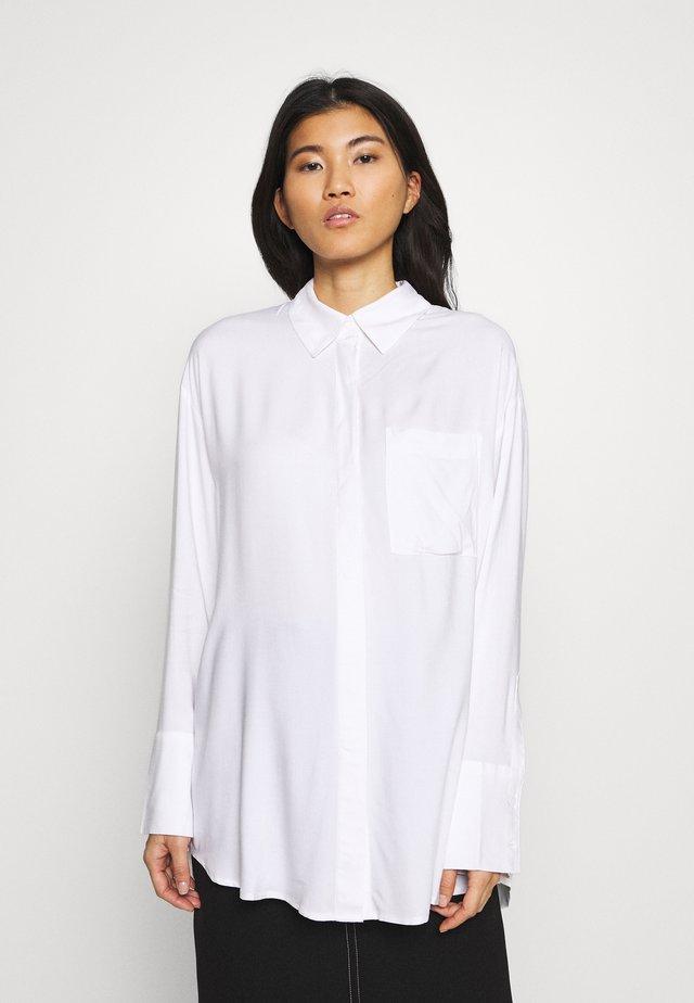 FREE BLOUSE - Button-down blouse - white