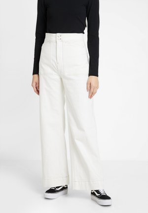 WORKER - Flared jeans - white