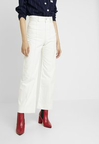 Weekday - COSMO TROUSERS - Flared Jeans - white - 0