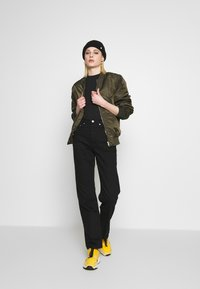 Weekday - ROW STAY - Straight leg jeans - black - 1