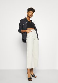 Weekday - LINEAR TROUSERS - Jeans straight leg - canvas - 1