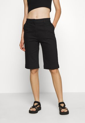 TAMIK - Shorts - black