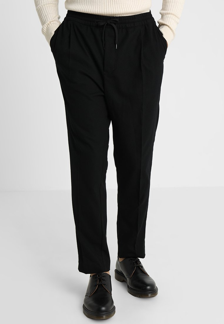 Weekday - THRILLER WOVEN JOGGERS - Trousers - black denim